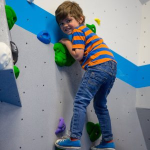 Louis climbing on VauxWall's shinny new walls.